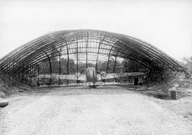 R.A.F., aircraft at dispersal on a Bengal airfield are protected from bomb blast by special bomb bays built of earth piled up against a bamboo frame work, Oct. 17, 1945.