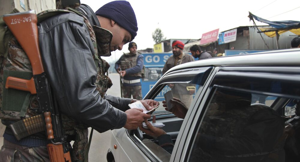 Indian security personnel check people entering an airbase in Pathankot, India, Monday, Jan. 4, 2016.