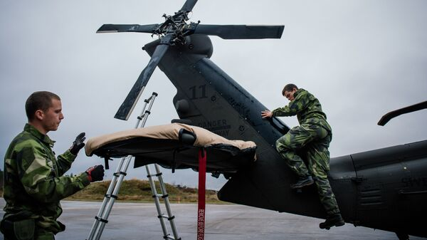 Soldiers from the Swedish Armed Forces prepare an Blackhawk helicopter at Hagshult Airbase, about 240km North-East of Malmo, Sweden - Sputnik International
