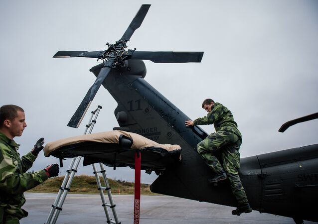 Soldiers from the Swedish Armed Forces prepare a Blackhawk helicopter at Hagshult Airbase, about 240 km North-East of Malmo, Sweden.
