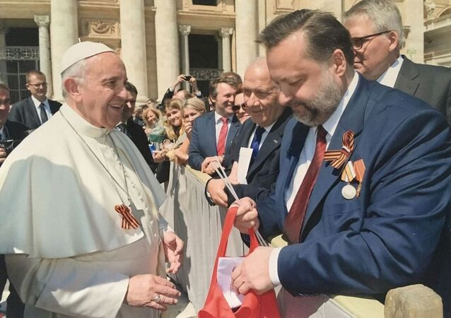 A Communist member of the Russian parliament has congratulated Pope Francis on the upcoming Victory Day and presented the Pontiff with a St. George ribbon, a widely recognized military symbol in Russia.