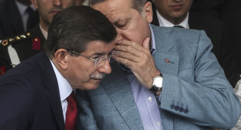 Turkey President Recep Tayyip Erdogan (R) speaks with Turkish prime minister Ahmet Davutoglu (L) (file)