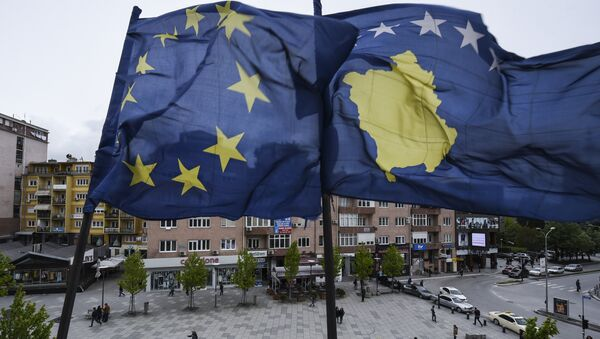 Kosovar Albanians walk under the EU and Kosovo flags in the main square of Pristina on May 4, 2016. - Sputnik International