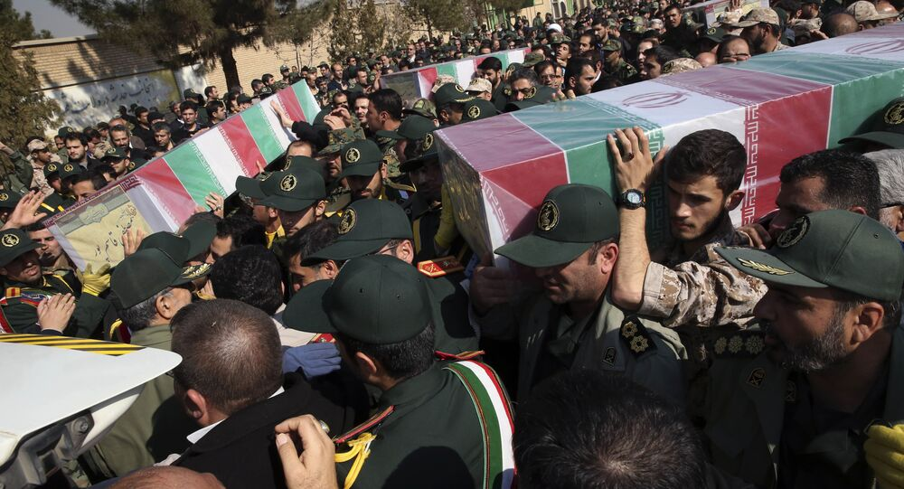 Civilians and armed forces members carry the flag draped coffins of Iranian Revolutionary Guard's Gen. Mohsen Ghajarian, right, and some of his comrades who were killed in fighting in Syria, during their funeral ceremony outside the headquarters of the guard's ground forces in Tehran, Iran, Saturday, Feb. 6, 2016.