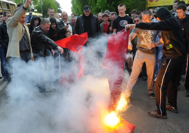 Supporters of nationalist parties burn red flags during a protest in Lviv, eastern Ukraine, during a Victory day celebration marking the anniversary of the end of WWII on May 9, 2011