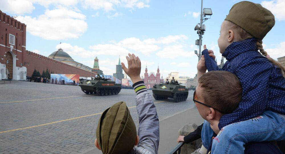 Spectators look at the rehearsal of the May 9 Victory Day Parade in Moscow