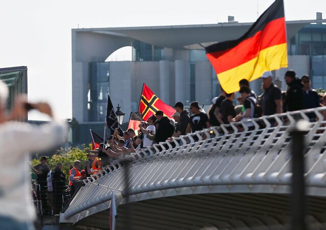 Right-wing protestors demonstrate against refugees, Islam and German Chancellor Angela Merkel in front of the chancellery in Berlin, Germany, May 7, 2016