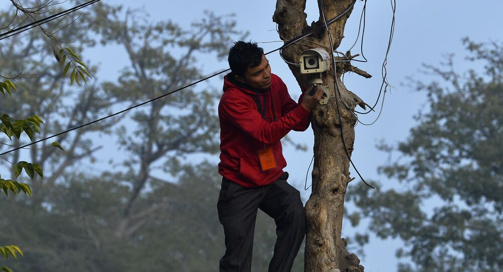 An Indian technician checks the CCTV camera at the roadside near the Presidential Palace as preparations for the nation's Republic Day parade take place in New Delhi on January 24, 2015