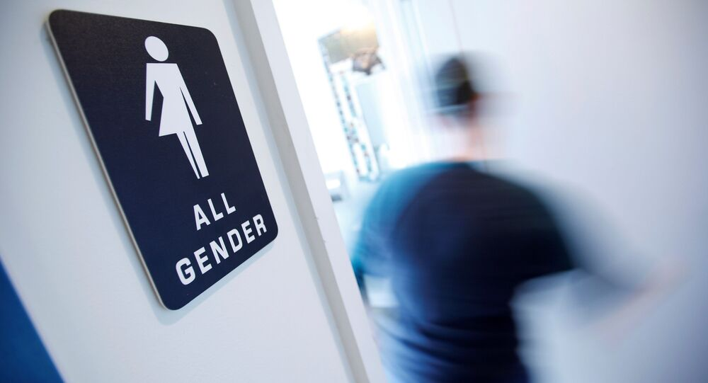A bathroom sign welcomes both genders at the Cacao Cinnamon coffee shop in Durham, North Carolina May 3, 2016