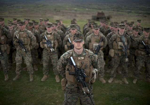 US army soldiers from the US Marine Corps stand in formation during a joint military training Platinum Lion 15-2 with Bulgaria's army at Novo Selo military ground on April 14, 2015