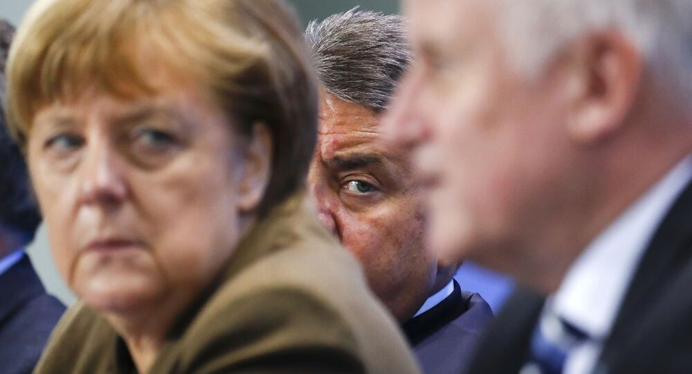 German Economy Minister Siegmar Gabriel (C) peers between Chancellor Angela Merkel and Bavarian state premier and leader of the Christian Social Union (CSU) Horst Seehofer during a news conference at the Chancellery in Berlin, Germany, April 14, 2016.