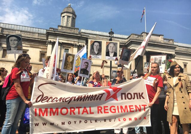 Participants of the London regiment march in London.