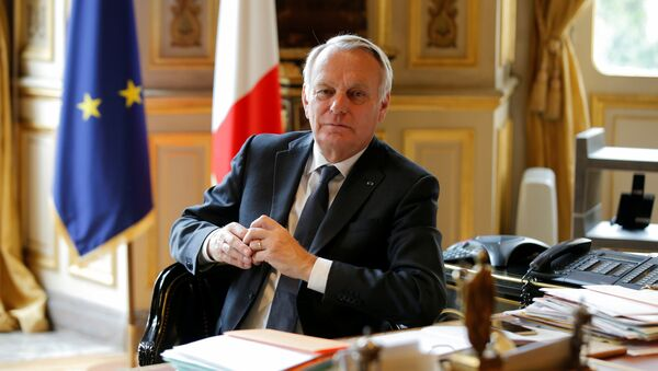 French Foreign Affairs Minister Jean-Marc Ayrault poses in his office at the Quai d'Orsay ministry in Paris, France, April 26, 2016 - Sputnik International