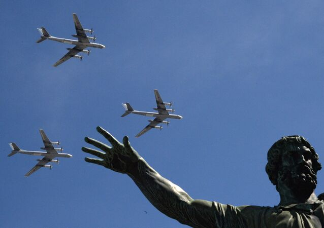 The Tu-95MS bombers are seen flying during the rehearsal of the May 9 Victory Day Parade in Moscow