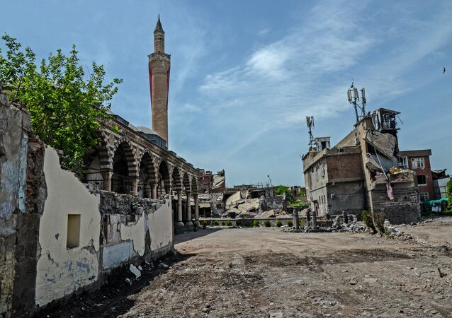 Damaged houses and a mosque are pictured in the historical district in Diyarbakir, southeastern Turkey, on May 5, 2016
