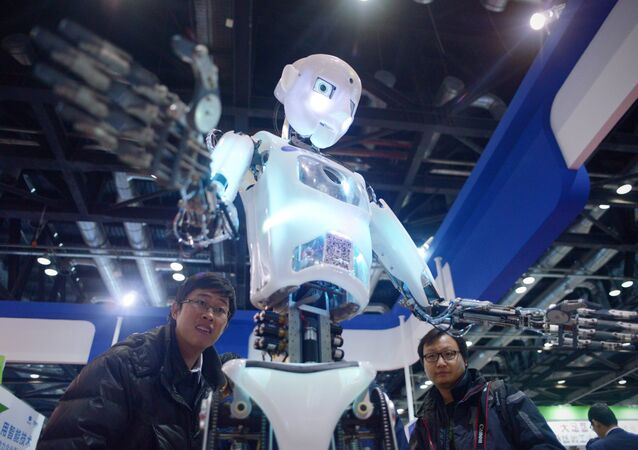 China-science-computer-robot, by Ben DOOLEY This picture taken on November 24, 2015 shows visitors watching a robot (C) demonstration during the World Robot Conference in Beijing