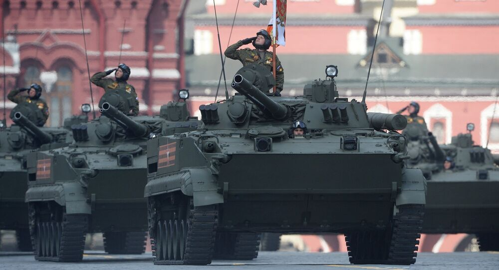 Troops ride BMP-3 infantry fighting vehicles on Red Square, Moscow during the final practice of the military parade marking the 71st anniversary of the victory in the Great Patriotic War