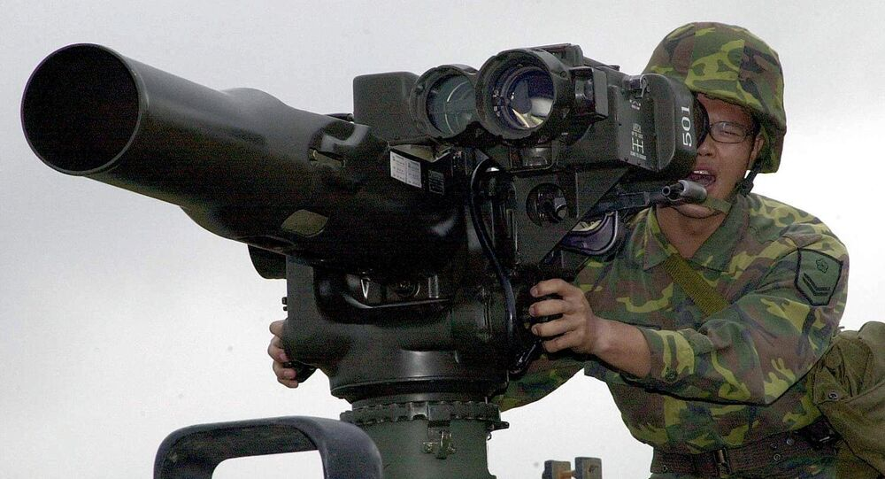 A military soldier operates a TOW anti-tank missile launcher. File photo