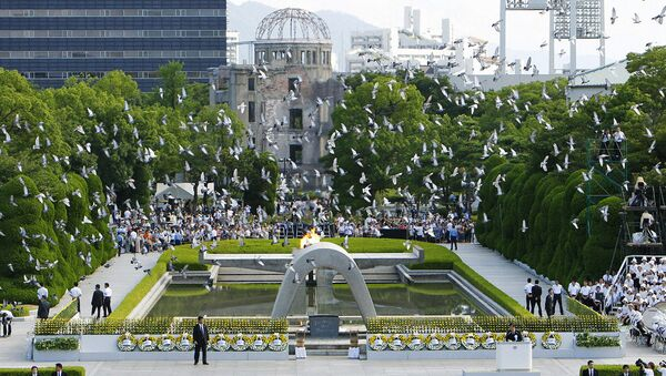 Doves fly over the Peace Memorial Park with a view of the gutted A-bomb dome at a ceremony in Hiroshima, Japan August 6, 2010 - Sputnik International