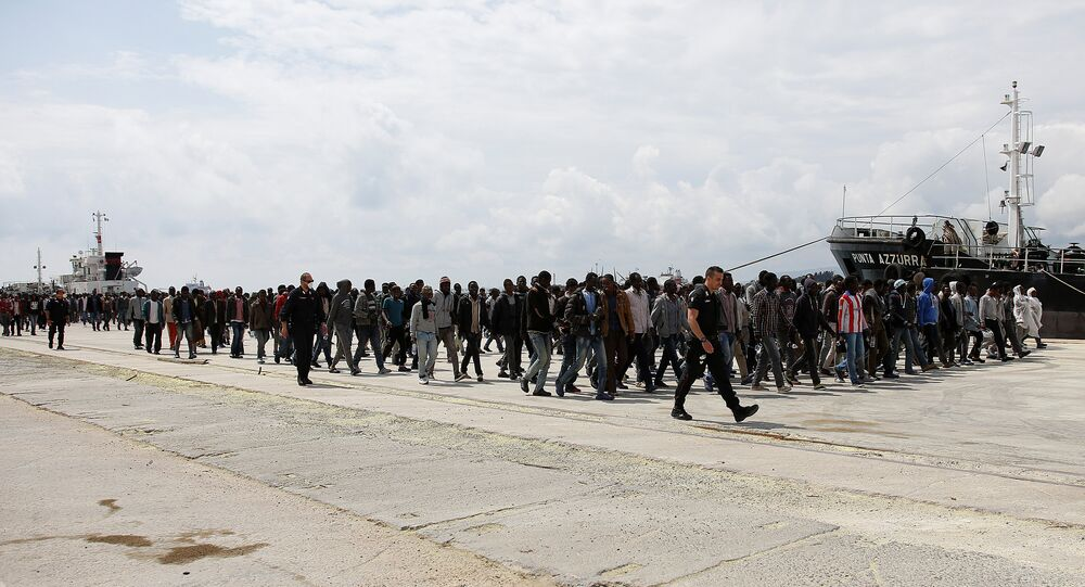 Migrants disembark from the Italian Navy vessel Grecale in the Sicilian harbour of Augusta, Italy May 7, 2016