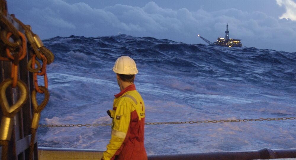 A worker on board the Bourbon Orca tug boat looks at the sea as they prepare to unload drilling equipment for an oil in the Norwegian sea (File)