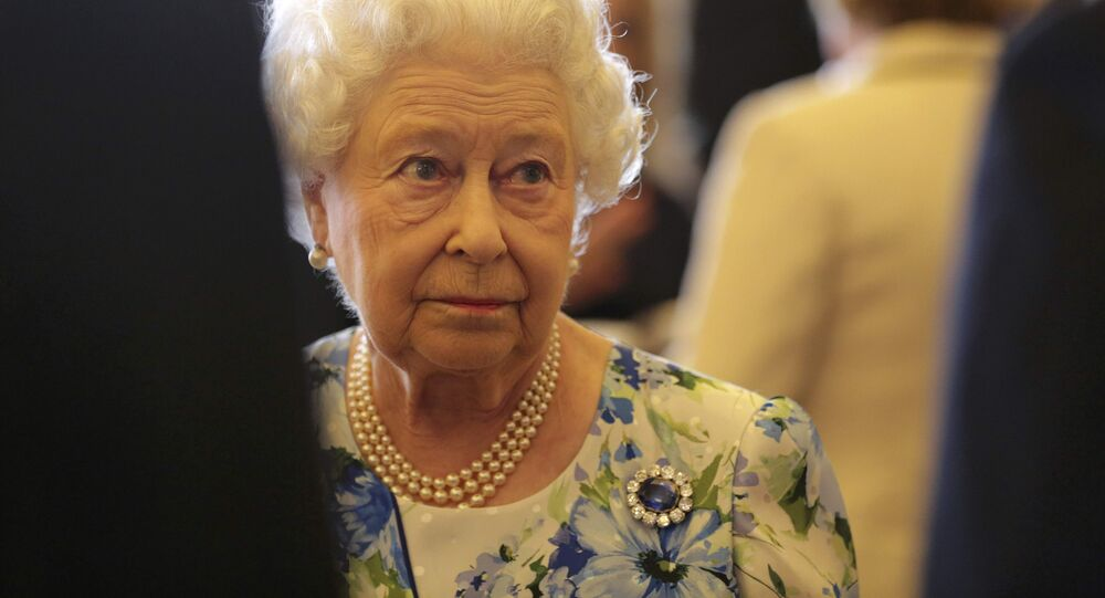 Britain's Queen Elizabeth speaks to Prime Minister David Cameron during a reception in Buckingham Palace to mark the the Queen's 90th Birthday, in London, Britain May 10, 2016.
