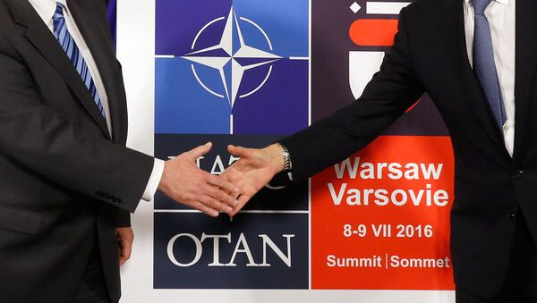 Logo for the upcoming NATO Warsaw summit 2016 - Sputnik International