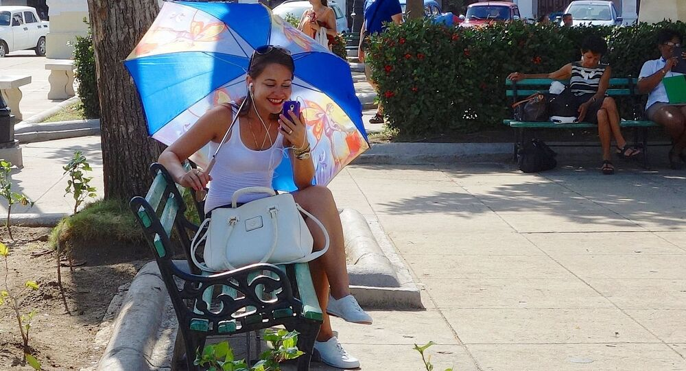 A woman using her mobile phone in Cuba.