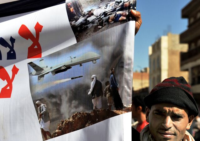 A Yemeni hold up a banner during a protest against US drone attacks on Yemen close to the home of Yemeni President Abdrabuh Mansur Hadi, in the capital Sanaa, on January 28, 2013.