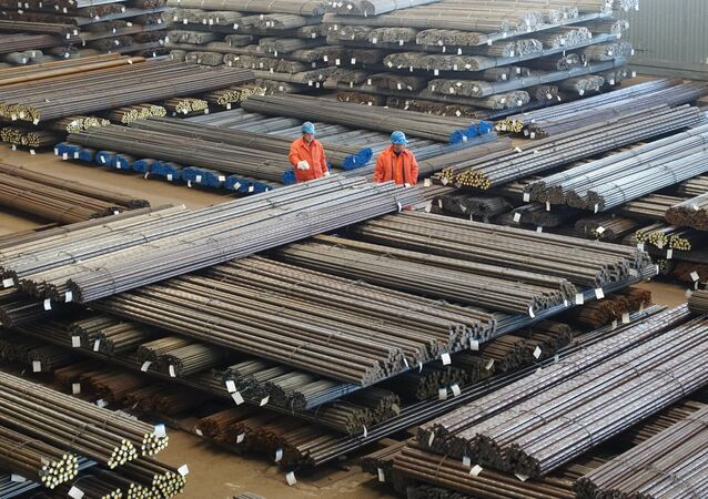 Workers check steel products at a factory in Dalian, Liaoning Province, China, March 30, 2016