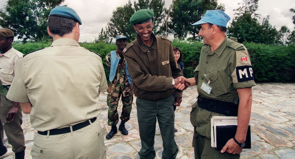 A picture taken 11 May 1994 in Buymba of Paul Kagame, leader of the Tutsi-led RPF (Rwandan Patriotic Front) shaking hands with an unidentified Canadian UN officer.