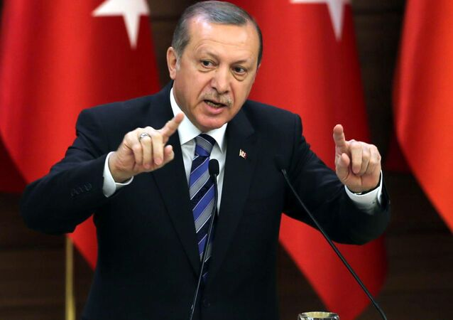 Turkish President Recep Tayyip Erdogan delivers a speech during.
