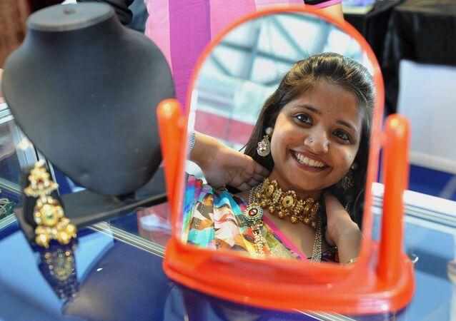 An IndAn Indian woman looks in the mirror (File)