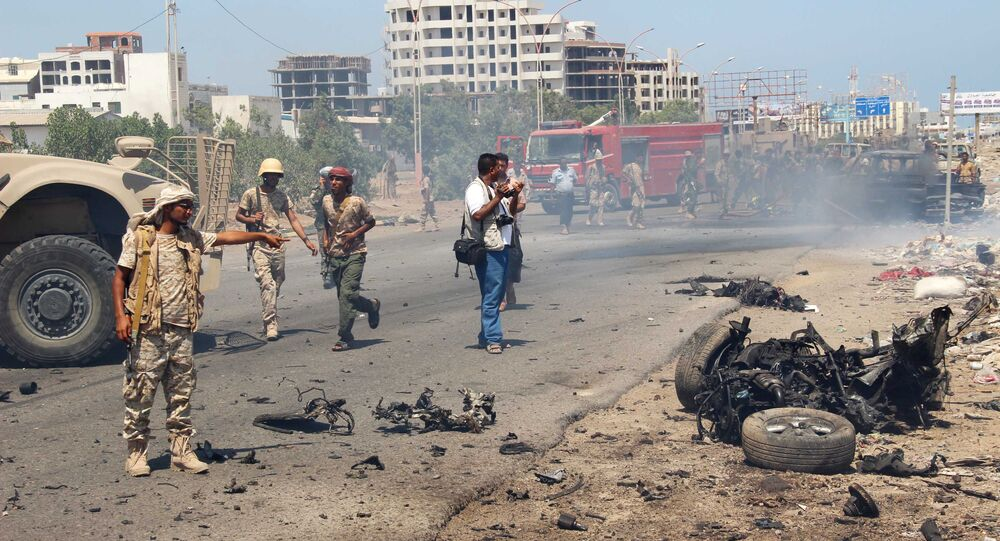 File photo of the soldiers gather at the site of a car bomb attack in a central square in the port city of Aden, Yemen, May 1, 2016