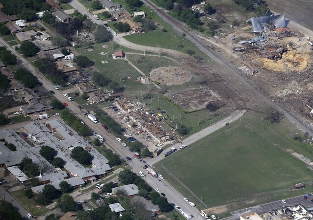This April 18, 2013, file aerial photo shows the remains of a nursing home, left, apartment complex, center, and a fertilizer plant, right, destroyed by an explosion in West, Texas