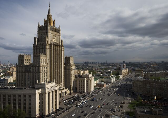 Cars drive past the Russian Foreign Ministry building in Moscow.