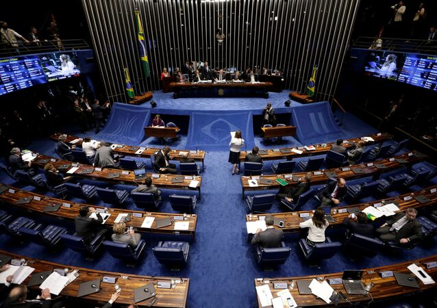 Members of Brazil's Senate, in favor and against the impeachment of President Dilma Rousseff, participate in the debate leading up to the voting in Brasilia, Brazil, May 11, 2016.