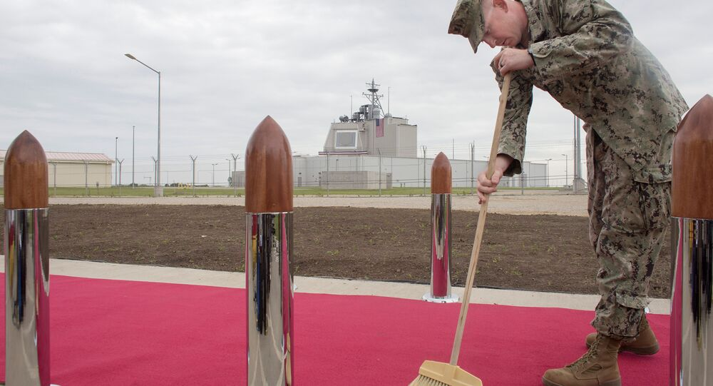 US Army personnel cleans the red carpet ahead of an official inauguration ceremony at Deveselu air base, Romania, May 12, 2016.