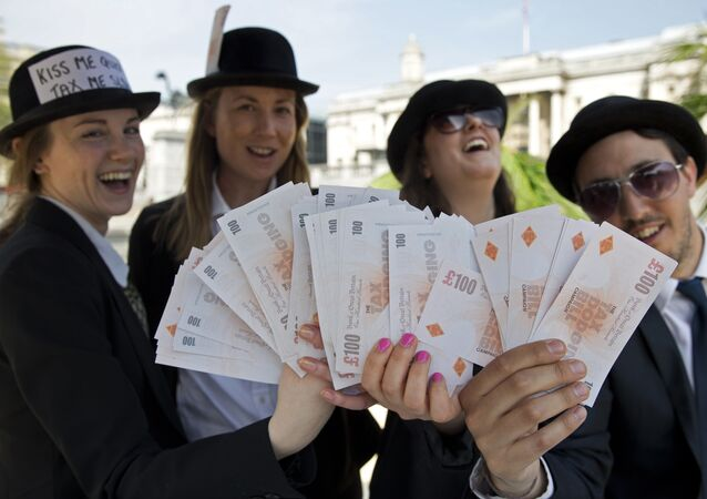 Demonstrators dressed as businessmen protests against tax avoidance at a tropical 'tax' haven in central London on May 12, 2016, near the venue of the Anti-Corruption Summit London 2016.