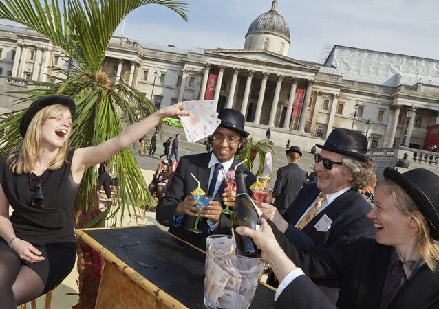 London's Trafalgar Square transformed into an interactive, tropical tax haven by Oxfam, Action Aid and Christian Aid.