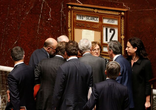 Deputies collect the result of a no-confidence vote against French government at the National Assembly in Paris, France, May 12, 2016.
