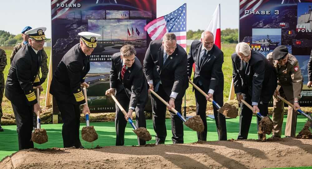 US Deputy Secretary of Defence Bob Work (C), Polish Minister of Defence Antoni Macierewicz (3rdR), Polish Foreign Affairs Minister Witold Waszczykowski (2ndR) and other officials take part in ground breaking ceremony of the northern section of defence anti-missile shield in Redzikowo military base in northern Poland