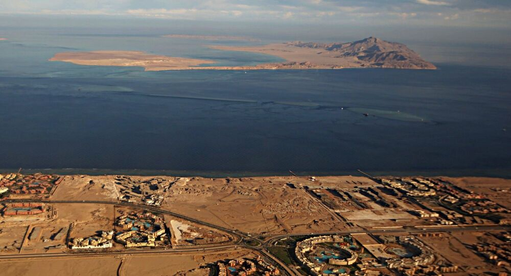 A picture taken on January 14, 2014 through the window of an airplane shows the Red Sea's Tiran (foreground) and the Sanafir (background) islands in the Strait of Tiran between Egypt's Sinai Peninsula and Saudi Arabia.