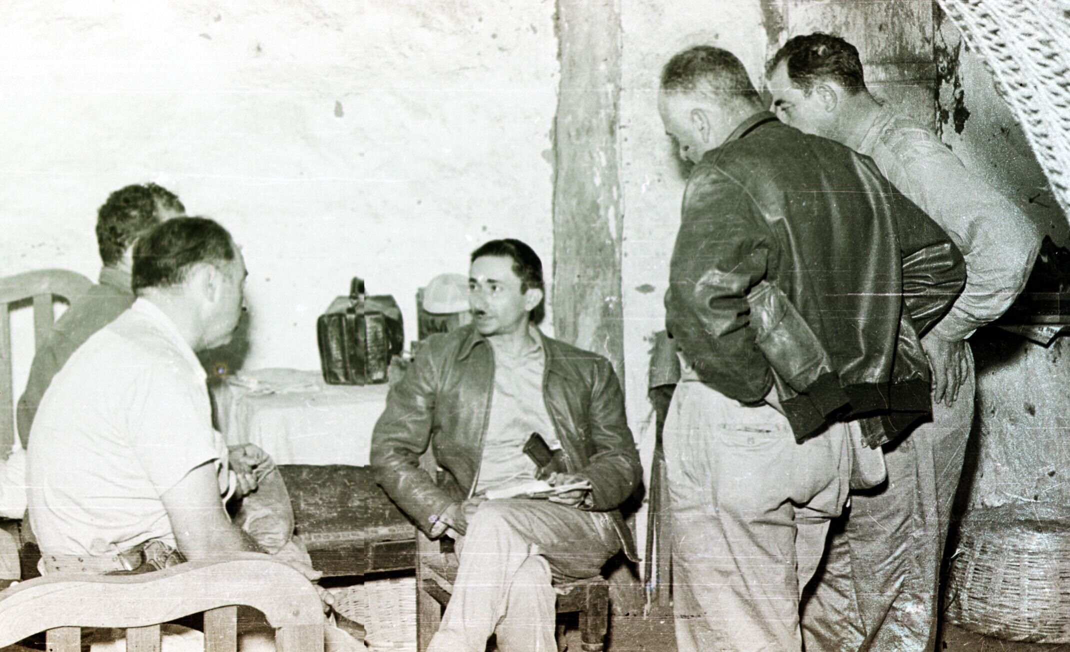 This 1954 file photo shows Guatemalan Col. Castillo Armas (C) surrounded by supporters days before Armas led a coup that deposed President Jacobo Arbenz. Armas assumed the presidency 01 September and would be assassinated while in office 26 July 1957