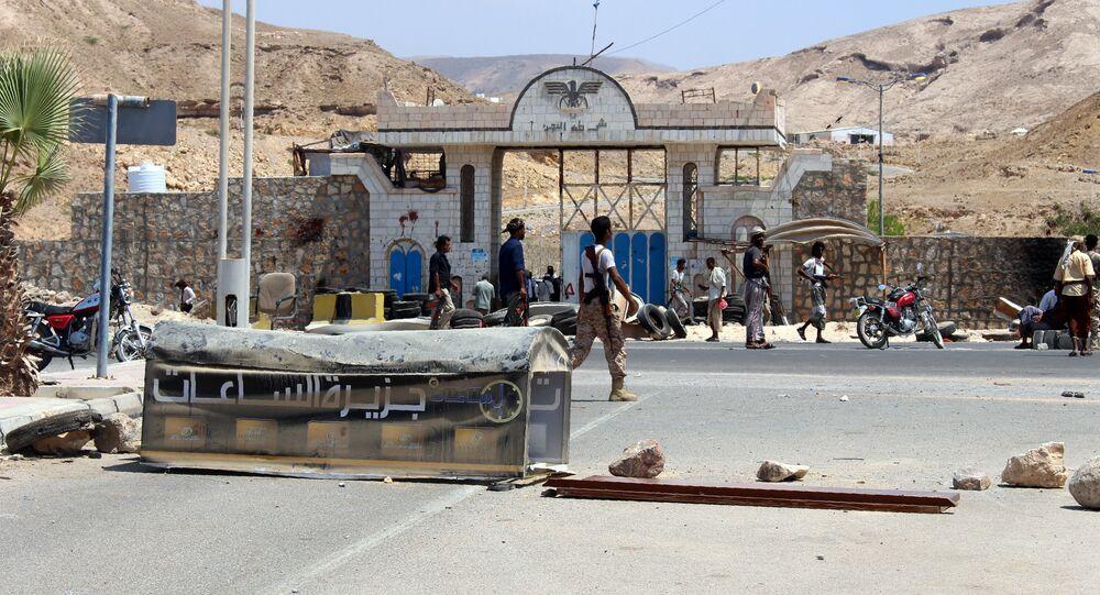 Yemeni soldiers stand guard outside a public security camp following a reported suicide attack in the southeastern Yemeni port of Mukalla