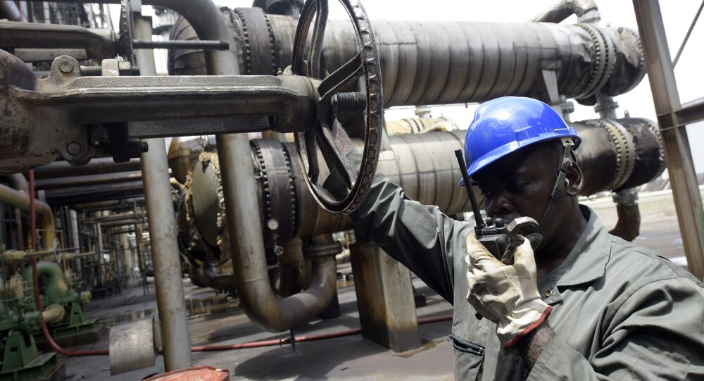A worker speaks to the control room at the new Port Harcourt refinery in Nigeria. file photo