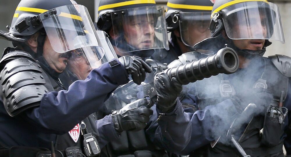 Riot police confront protestors during a demonstration against French labour law reform in Paris, France, May 12, 2016