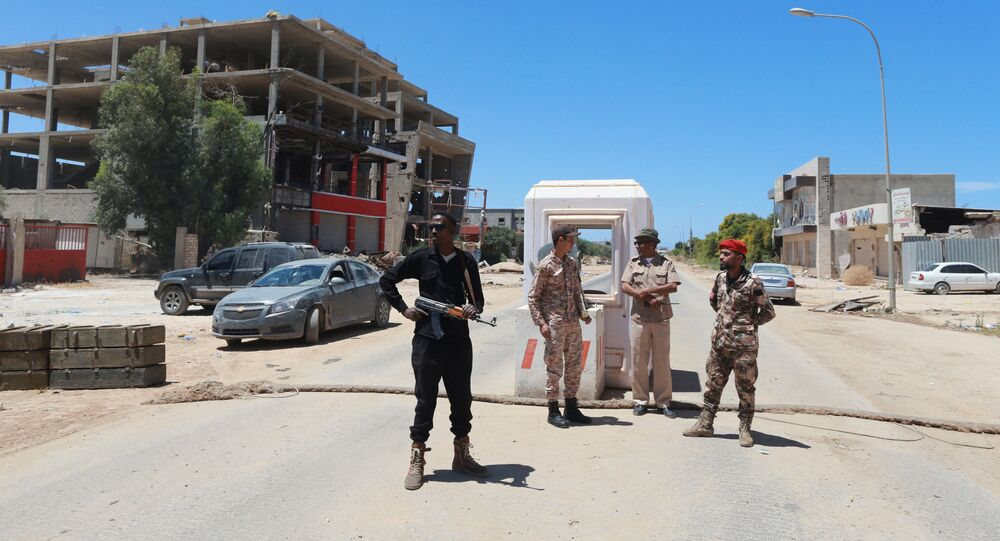 Members for the Libyan Armed Forces stand at the checkpoint in Benghazi, Libya May 16, 2016