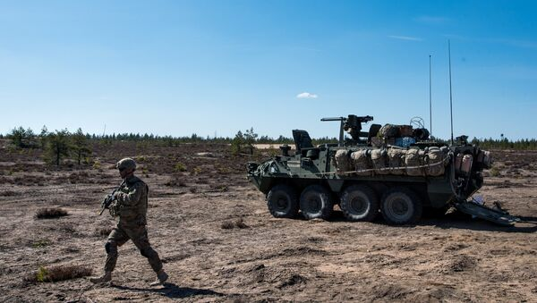 US army soldier and Stryker armored vehicle during Arrow 16 mechanised exercise of the Finnish Army in collaboration with US Army Europe's 2nd Cavalry Regiment's Mechanized Infantry Company in Niinisalo, Finland (File) - Sputnik International