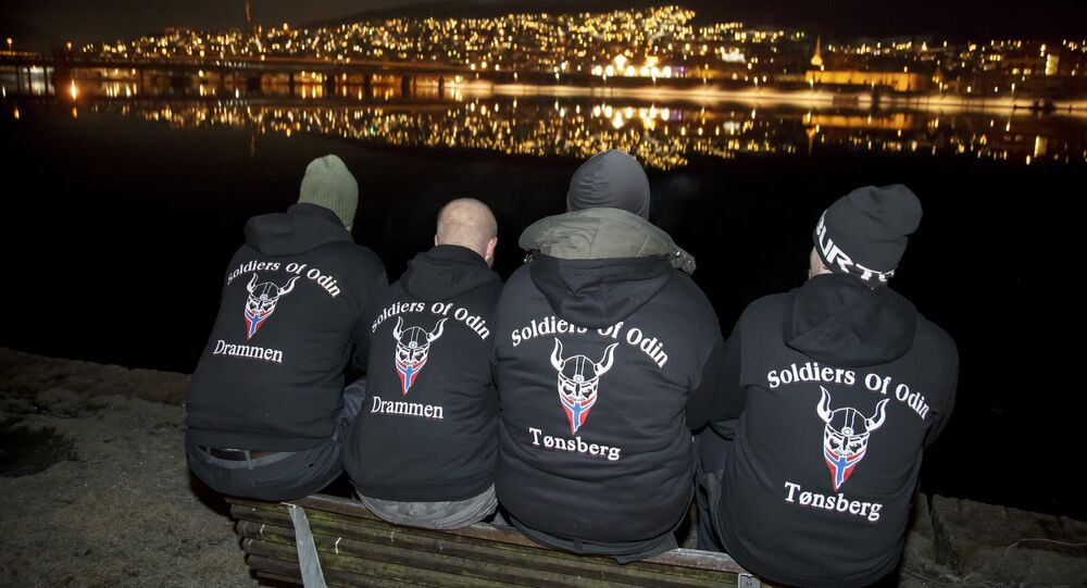 Members of the so-called Soldiers of Odin volunteer street patrol are pictured as they patrol through the streets of Drammen, Norway, on Sunday night, February 21, 2016